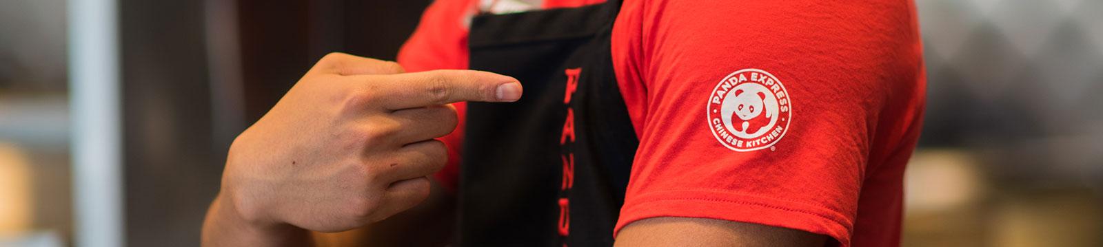 Panda employee pointing to logo